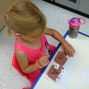 Pre-k student Emma sorting letters