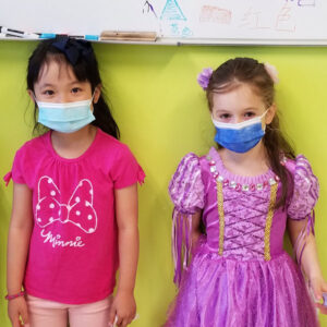Two pre-k girls play dress up