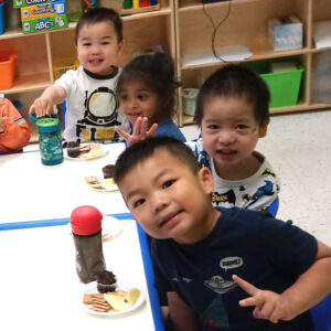 Group of preschool boys take a break from lunch to pose for a photo