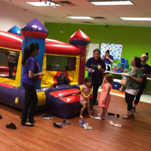Kids playing in a bouncy house