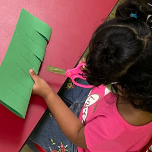 Young girl cutting paper