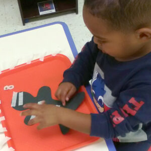 Mikey creating a halloween art project