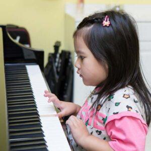 Preschool girl playing piano