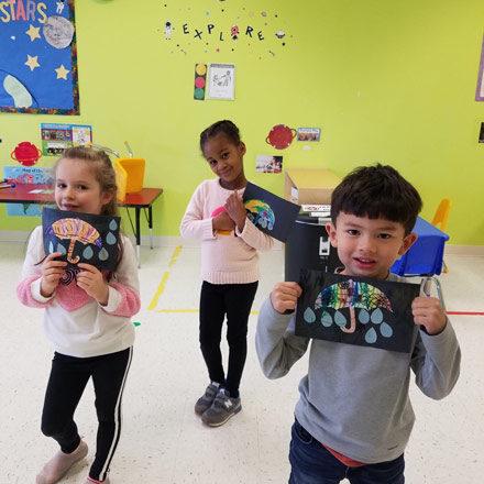 Pre-K kids showing off their artwork